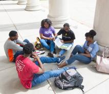 Students sitting on steps of Rockwell Hall
