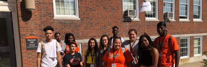 Tour group five of the Summer Bridge students standing in front of Rockwell Hall