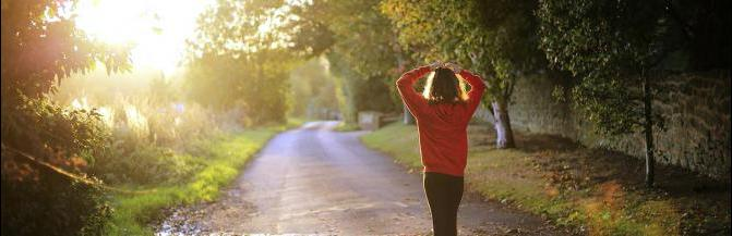 Woman walking down country road